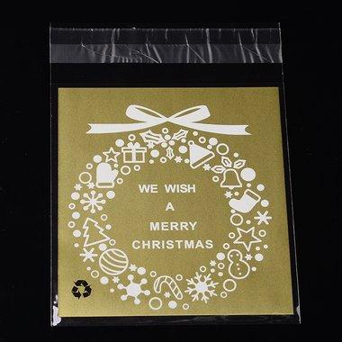 10 cellofaan zakjes met plakstrip goud We wish a merry christmas