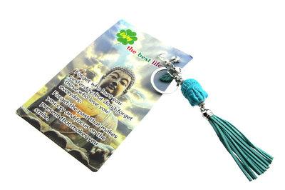 Sleutelhanger boeddha hoofd turquiose met kwastje
